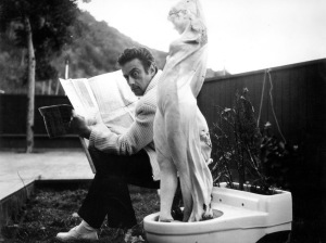 Lenny Bruce reads a newspaper from circa 1970